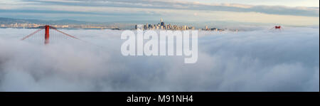 Large Panorama of Downtown San Francisco Floating on White Clouds at Sunset - Stock Photo