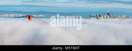 DownTown San Francisco Floating on White Clouds with Golden Gate Bridge and Bay Bridge in the Background - Stock Photo