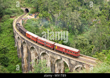 An aerial view of a train passing over the Nine arches Bridge near Demodara in Sri Lanka. - Stock Photo