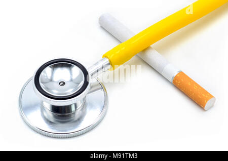 Stethoscope with cigarette  isolated - Stock Photo