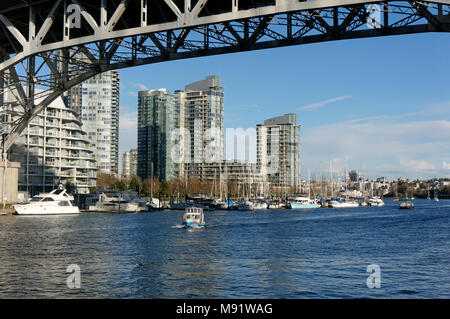 An aquabus ferry on False Creek passing under the Granville Bridge, Vancouver, BC, Canada - Stock Photo