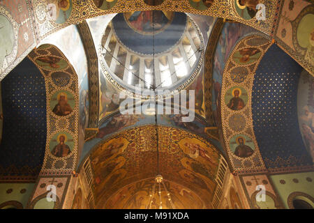 Murals and frescos decorate the Interior of Sioni Cathedral (Georgian Orthodox) as rays of sunlight enter through a side window, Tbilisi, Georgia - Stock Photo