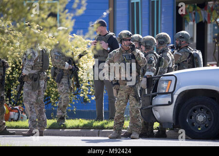 Police SWAT teams secure the Pflugerville, TX, neighborhood around the home of Mark Conditt, who was the suspected serial bomber terrorizing Austin for three weeks. Conditt killed himself earlier in the day during a car chase as officers closed in. - Stock Photo