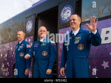 Baikonur Cosmodrome, Kazakhstan. 21st Mar, 2018.  International Space Station Expedition 55 crew Drew Feustel of NASA, left, Soyuz Commander Oleg Artemyev of Roscosmos, center, and flight engineer Ricky Arnold of NASA, right, wave farewell to family and friends as they depart the Cosmonaut Hotel to suit-up for their Soyuz launch to the International Space Station from the Baikonur Cosmodrome March 21, 2018 in Baikonur, Kazakhstan. Credit: Planetpix/Alamy Live News - Stock Photo