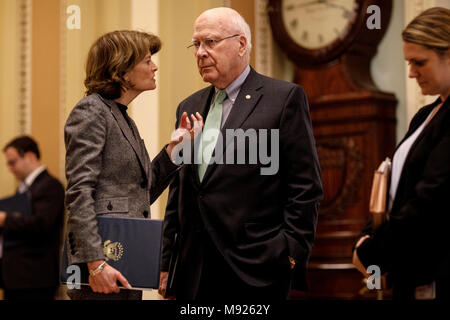 Washington, USA. 21st March, 2018. United States Senator Lisa Murkowski, Republican of Alaska, and Senator Patrick Leahy, Democrat of Vermont, talk outside the Senate chamber following a vote at the United States Capitol Building in Washington, DC on March 21, 2018. Credit: Alex Edelman/CNP /MediaPunch - Stock Photo