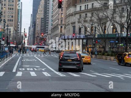 New York City - Circa 2018: Manhattan street view morning traffic driving on avenue through herald square - Stock Photo