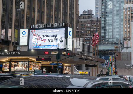 New York City - Circa 2018: Madison Square Garden outside marquee banner advertising Knicks basketball game - Stock Photo