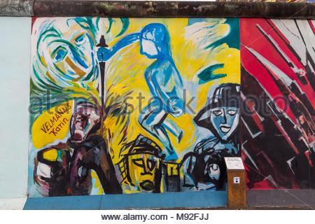 BERLIN, GERMANY - DECEMBER 16, 2017: Mural painted over Berlin Wall ...