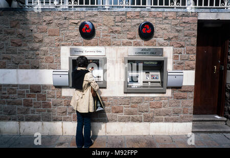 Natwest bank ATM, automated teller machines, one issueing sterling currency only, the other Jersey currency only, St helier, Jersey, Channel Islands - Stock Photo