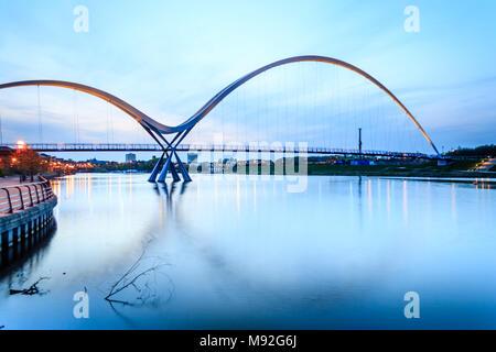 Evening Light on the Infinity Bridge in Stockton on Tees. - Stock Photo