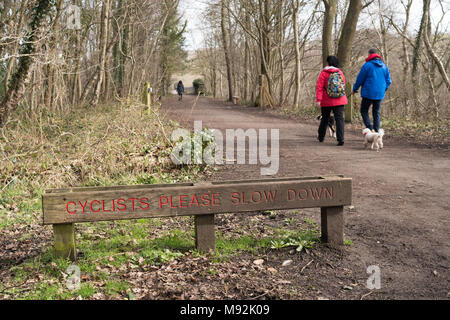 Sign Cyclists Please Slow Down on the Derwent Walk ex railway path, north east England, UK - Stock Photo