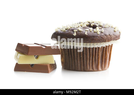 Tasty chocolate muffins and chocolate bars isolated on white background. - Stock Photo
