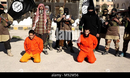 Islamic State propaganda photo showing a captured Syrian Army soldiers before being beheaded by ISIS terrorists following battles in Southern Damascus March 20, 2018 in Syria. - Stock Photo