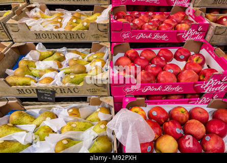 apples and pears on display at borough market in central london. greengrocers stall displaying fresh fruits and vegetables for sale on a market stall. - Stock Photo