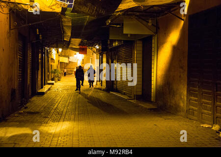 A dark mysterious alley in the Medina in Marrakesh, Morocco - Stock Photo