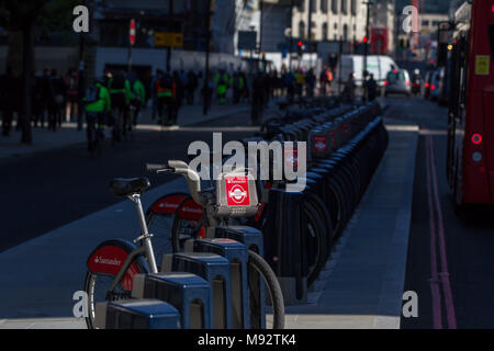 A Santander Cycles docking station.  Santander Cycles (Boris Bikes) is a public bike hire scheme, launched in London in 2010 - Stock Photo