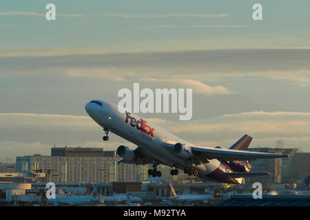 FedEx MD11 Cargo Jet Taking Off From Los Angeles International Airport,   LAX, After Sunrise. - Stock Photo