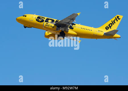 Spirit Airlines Airbus A319 Jet Airliner In The Bright Yellow Livery, Taking Off From Los Angeles International Airport, LAX, California, USA.