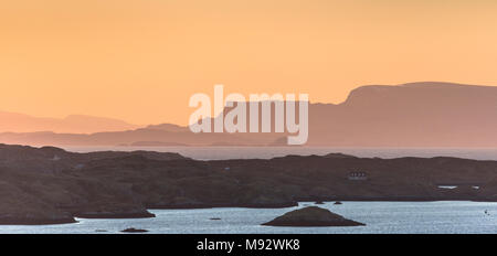 View over Scalpay and Isle of Skye looking out from Isle of Harris in the Outer Hebrides. - Stock Photo