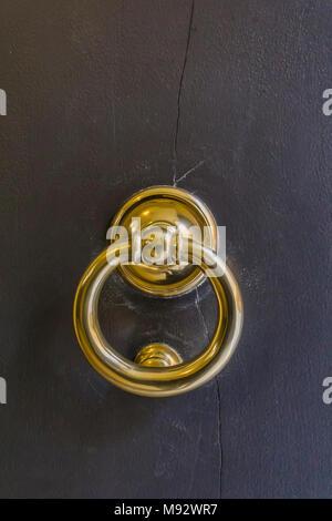 Vintage old door knob from wooden door in Modena, Italy - Stock Photo