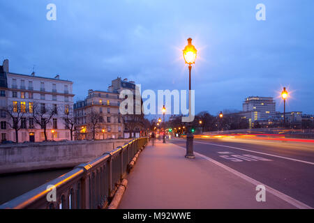 Pont de Sully bridge over Seine River, Ile Saint Louis, Paris, France - Stock Photo
