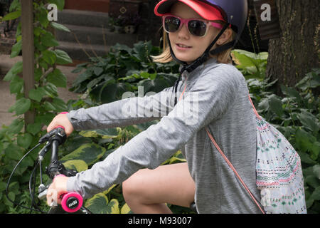 Girl age 10 on her bicycle ready to start on her adventure on wheels. St Paul Minnesota MN USA - Stock Photo