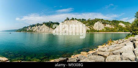 Scarborough Bluffs Canada Ontario showing coastal line with rocky hill terrain and lake on a beautiful sunny day - Stock Photo