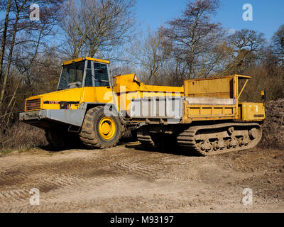 Heavy earth moving machinery used for restoration work on the North Walsham and Dilham Canal. - Stock Photo