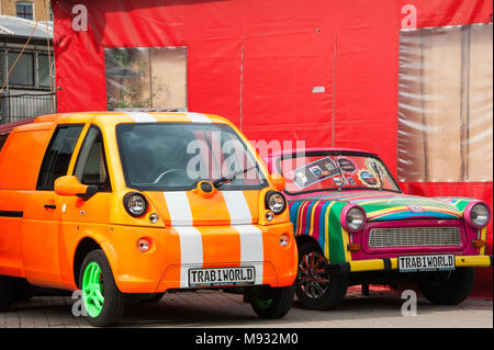 Brightly painted classic cars at Trabi World car museum and rental safaris in Berlin, Germany. - Stock Photo