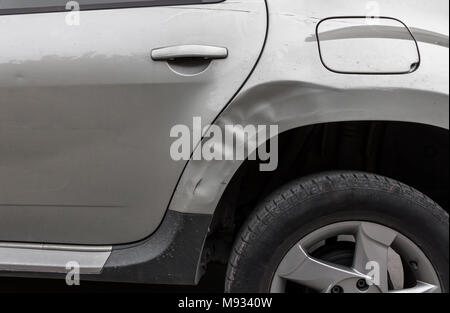 Dents on the car caused by the accident - Stock Photo