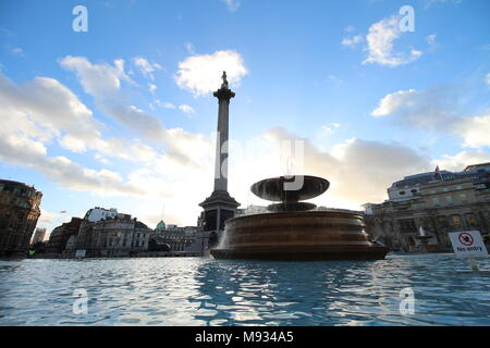 A fountain in Trafalgar square, London, England - Stock Photo