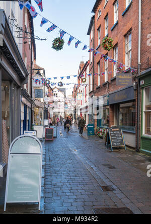 Male and female shoppers making their way along Church Street Hereford UK. March 2018 - Stock Photo