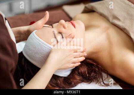 Beautiful woman at a facial massage at a spa salon - Stock Photo