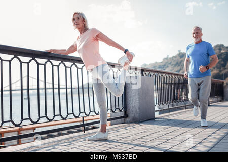 Senior pleasant couple spending time together and having training. - Stock Photo