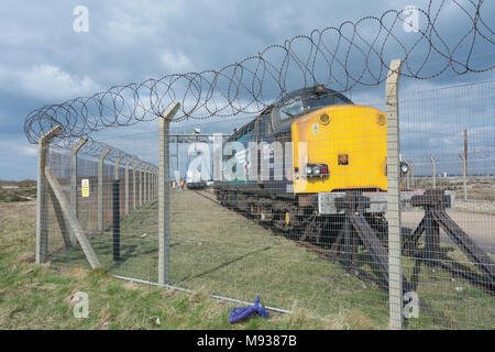An English Electric Class 37 diesel locomotive waits to take radioactive nuclear flasks away from Dungeness Nuclear Power station - Stock Photo