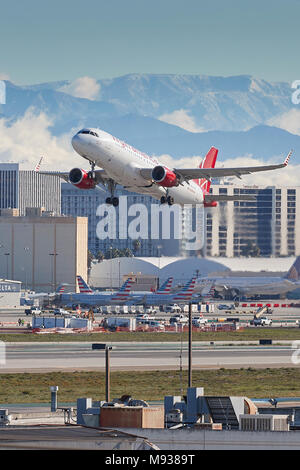 Virgin America Airbus A320 Jet Plane, Taking Off From Los Angeles International Airport, LAX, The Snow Covered San Gabriel Mountains Behind. - Stock Photo