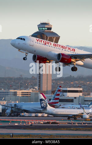 Virgin America Airbus A320 Jet Airliner, Taking Off From LAX, Los Angeles International Airport, The ATC Control Tower In Background. - Stock Photo