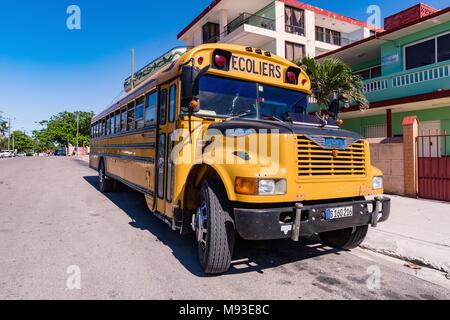 VARADERO, CUBA - MARCH 04, 2018: American school bus in Varadero. Old american school bus on the street. Cuba. - Stock Photo