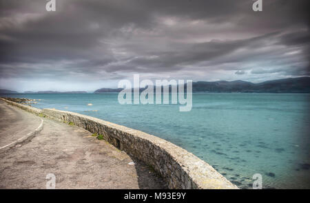 Anglesey coastline,roadside parking wIth stunning view near Beaumaris,North West UK. - Stock Photo