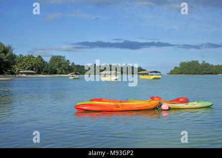 Landscape view of colorful kayaks at Muri Lagoon in Rarotonga, Cook Islands.