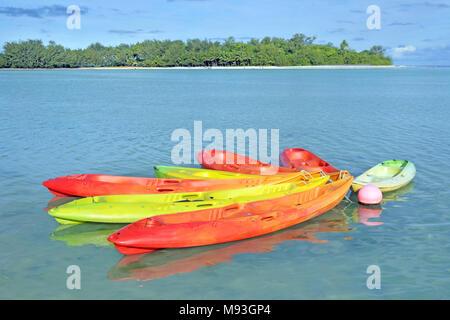Landscape view of colourful kayaks at Muri Lagoon in Rarotonga, Cook Islands.