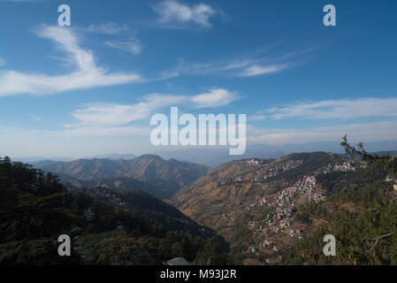 Scenic beautiful mountain landscape valley and town nature with blue sky and clouds in Shimla to Kalka in Himachal Pradesh, North India, India, Asia - Stock Photo