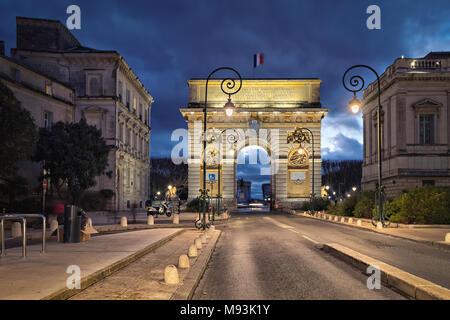 The Porte du Peyrou -  a triumphal arch in Montpellier at dusk, Occitanie, France - Stock Photo