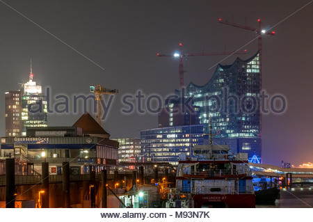 Hamburg, Germany - 03. April, 2014: Evening View at, now pulled down Restaurant Ueberseebruecke and construction site of Elbphilharmonic Concert Hall. - Stock Photo