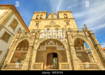 Braga, Portugal. Bottom view of facade of Braga Cathedral with its gothic bell towers. Se de Braga is the oldest cathedral in Portugal, Europe. - Stock Photo