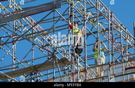 Scaffolders working on residential house under construction in East Lothian , Scotland, United Kingdom - Stock Photo