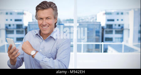 Composite image of businessman using mobile phone while having breakfast against white background - Stock Photo