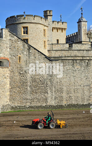 London, England, UK. Tower of London (11th-14thC) Small tractor plowing up land in the moat (March 2018) Devereux Tower (L) - Stock Photo