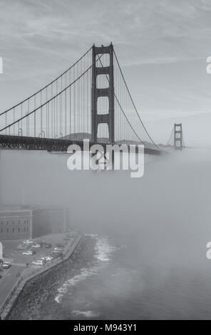 View of the Golden Gate Bridge and Fort Point with thick low fog,  San Francisco, California, United States. - Stock Photo