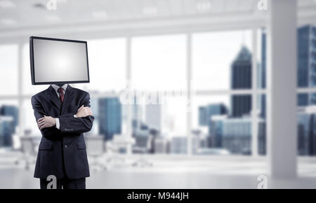 Cropped image of businessman in suit with TV instead of head keeping arms crossed while standing inside office building. - Stock Photo